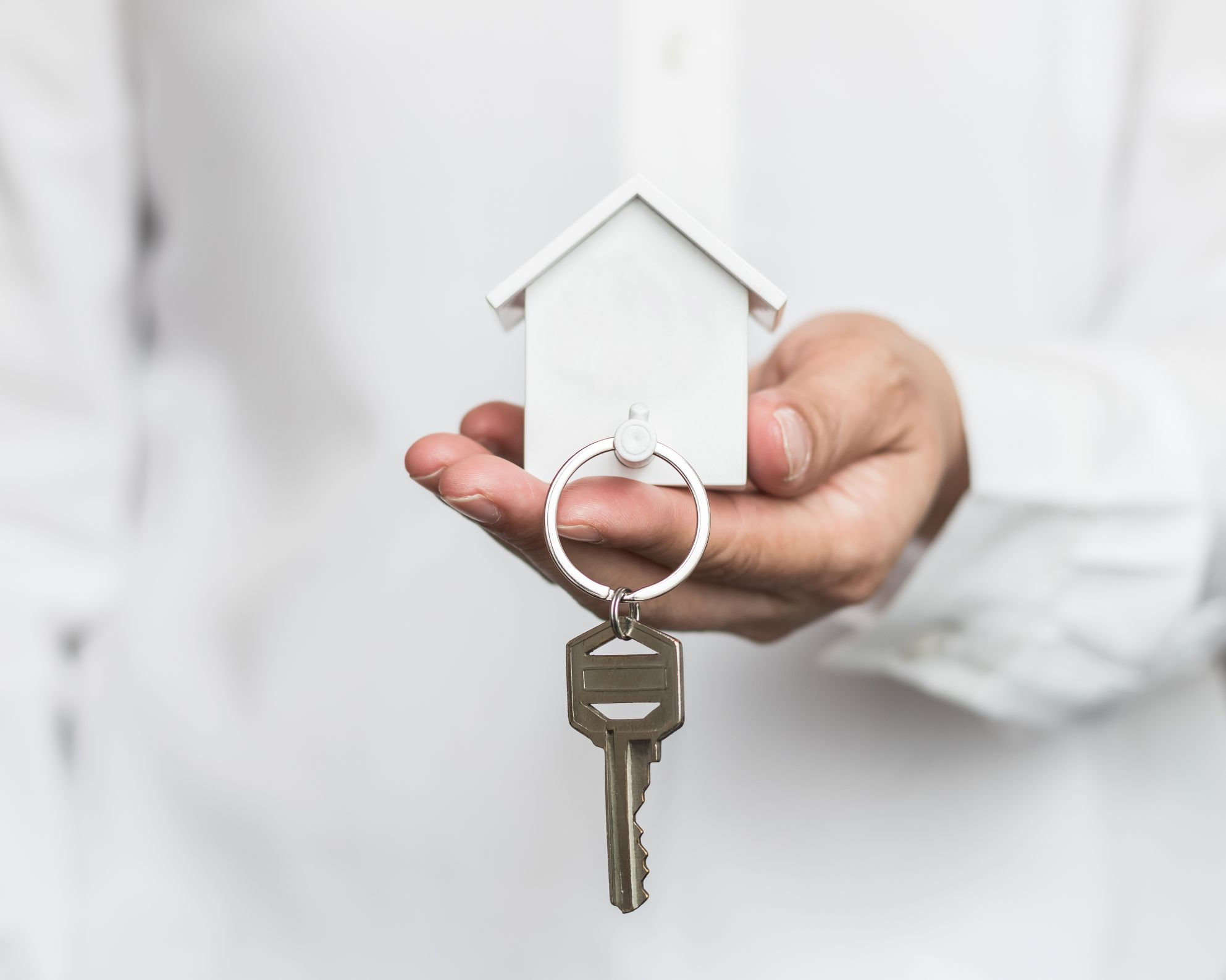 hand holding keys to a property for sale
