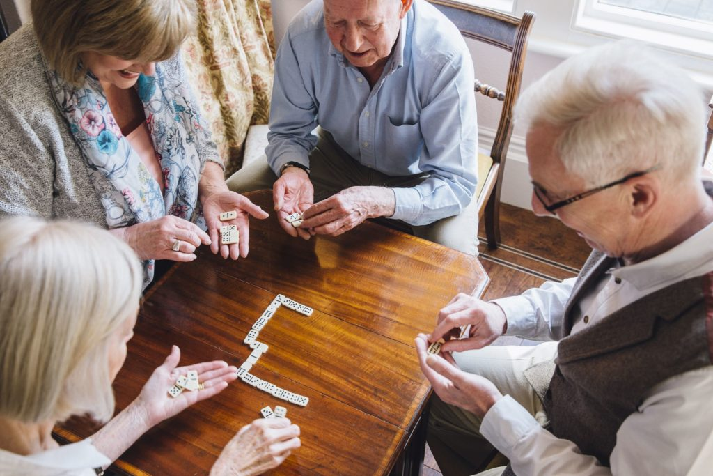 senior citizens playing games in a retirement community